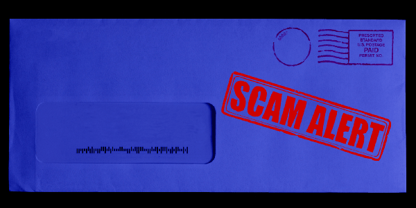 """Blue tinted mailing envelop with bright red """"SCAM ALERT"""" stamp"""